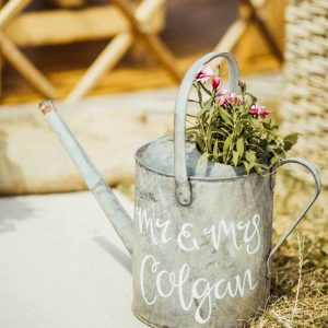 Watering can with added calligraphy
