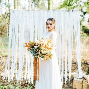 Macrame Backdrop available to hire. Photo from Nikkis Moments Photography.