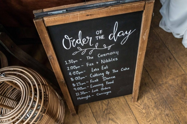 Order of The Day Chalkboard A Frame with calligraphy writing