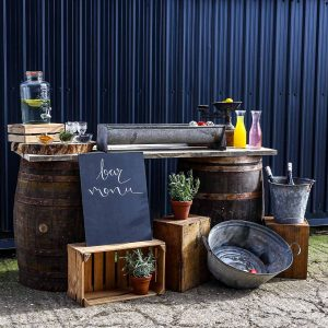 Beautifully Rustic Whisky Barrel Bar Styled With Metal Baths and Buckets