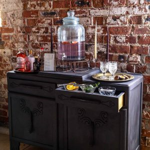 The Perfect Gin Table. Vintage Dresser, brass trays, glass bowls and elegant candles.