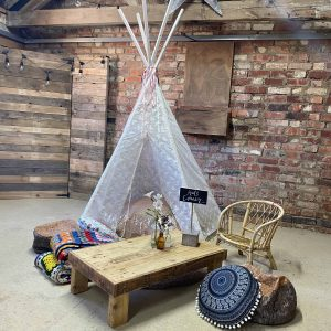 Kids Corner styling. Featuring lace tipi and lots of cushions.